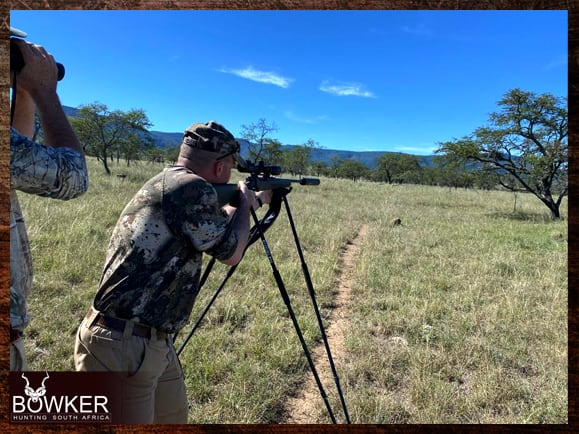 Client using shooting sticks while hunting in South Africa
