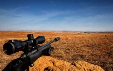 Rifle rest on an anthill. Your Hunt will be a fair chase in a free-range hunting environment.